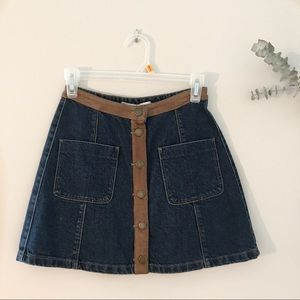 Blue denim button up skirt with rust color trim